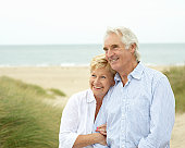 Elderly couple together at beach.