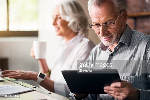 Elderly couple together at the kitchen : Stock-Foto