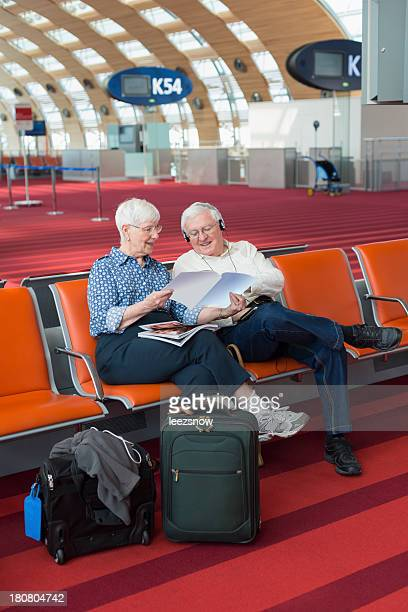 Elderly Couple Waiting at the Airport