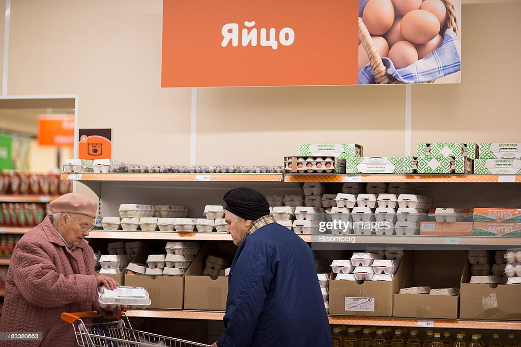 Elderly customers shop for fresh eggs inside a Dixy supermarket operated by OAO Dixy Group in Moscow, Russia, on Tuesday, April 8, 2014. Suppliers suffering from ruble depreciation this quarter are urging retailers to increase prices. Photographer: Andrey Rudakov/Bloomberg via Getty Images