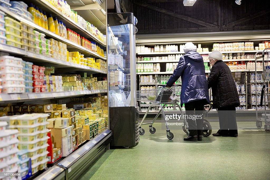 Elderly customers wheel their shopping carts through the chilled food section of an ICA supermarket store in Stockholm, Sweden, on Tuesday, Feb. 19, 2013. Hakon Invest AB, the minority owner of Sweden's largest food retailer ICA, agreed to take full control by acquiring partner Royal Ahold NV's 60 percent stake for 20 billion kronor ($3.1 billion). Photographer: Casper Hedberg/Bloomberg via Getty Images