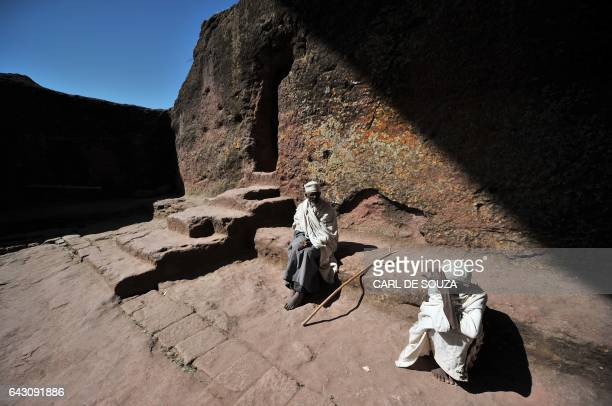Elderly Ethiopian Orthodox Christians take a moment to rest during the annual festival of Timkat in Lalibela on January 19 2012 The Timkat festival...