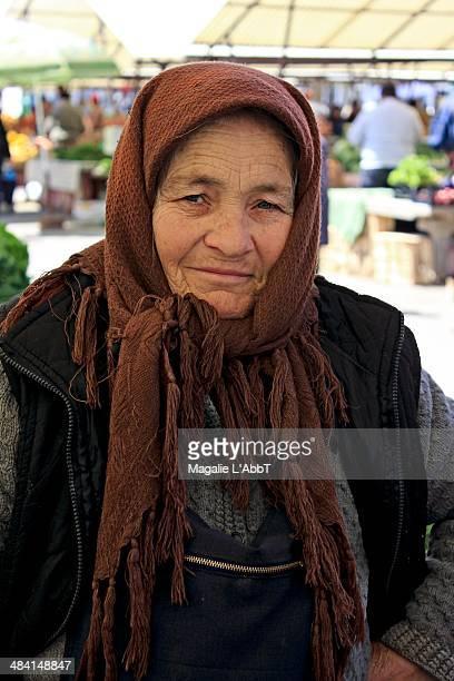 Elderly farmer at the local market still working despite old age