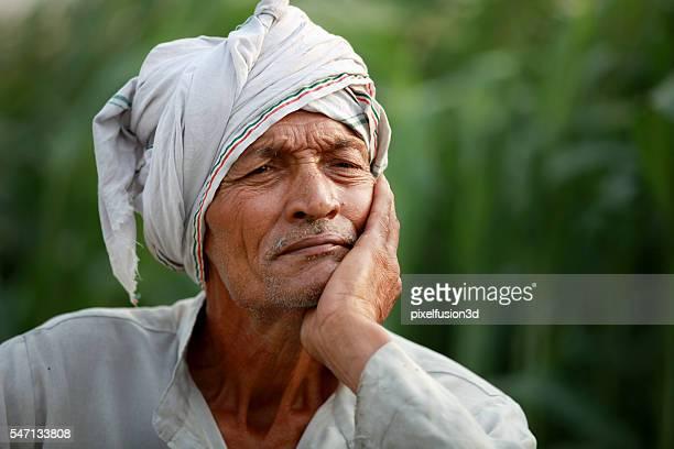 Elderly farmer man lost in thought