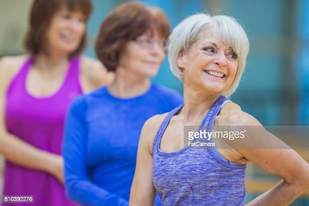 Elderly Group of Women Exercising Together