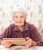Elderly happy woman read something