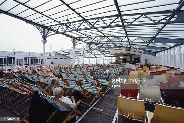 Elderly holidaymakers enjoy a sparsely attended musical performance in the seaside town of Blackpool Lancashire August 1983