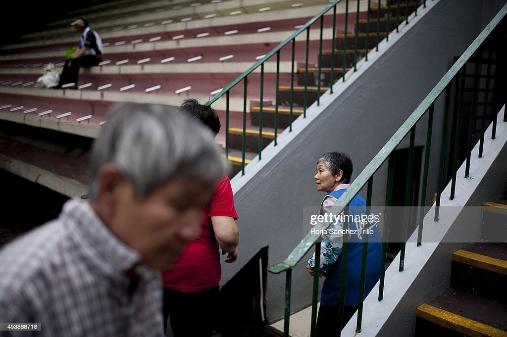 Elderly hongkongers are seen inside a public sports center on August 19, 2014 in Hong Kong, Hong Kong. A government-commissioned study headed by University of Hong Kong academic Nelson Chow Wing-sun proposed to fund HK $3,000 a month pension for every Hongkonger over 65, rich or poor, without a means test. The pension should be funded partly by contributions ranging from 1 to 2.5 per cent of employees' salaries, paid by employers and workers. One in three old people in Hong Kong lives below estimated poverty line some of them struggling to make a living collecting cardboard boxes and plastic bottles on the street.