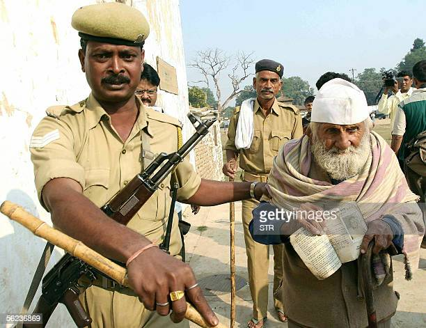 Elderly Indian voter Baldeb Raj Sawami is escorted by paramilitary soldiers as he prepares to cast his vote in state assembly elections in Patna19...