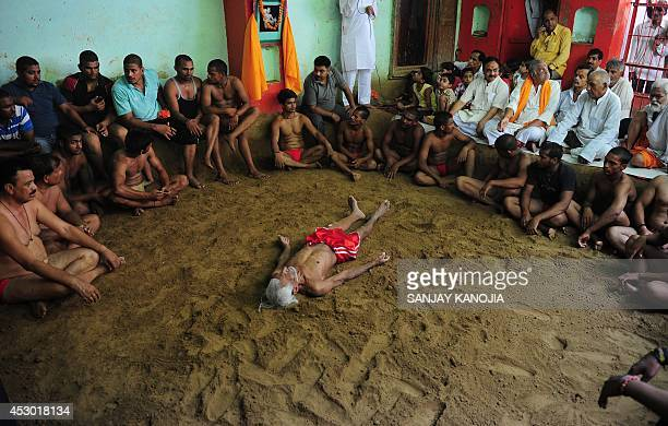 Elderly Indian wrestler Ram Gopal performs during a bout of traditional wrestling organized at the historical Loknath Vyayamsala on the occasion of...