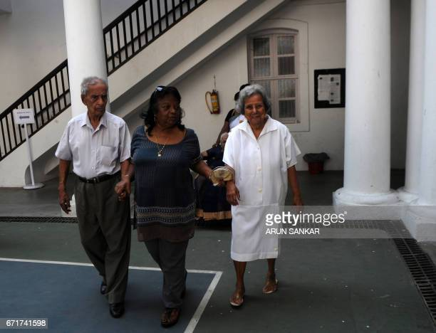 Elderly IndoFrench citizens arrive to cast their votes at a polling booth in Puducherry on April 23 during the first round of French presidential...
