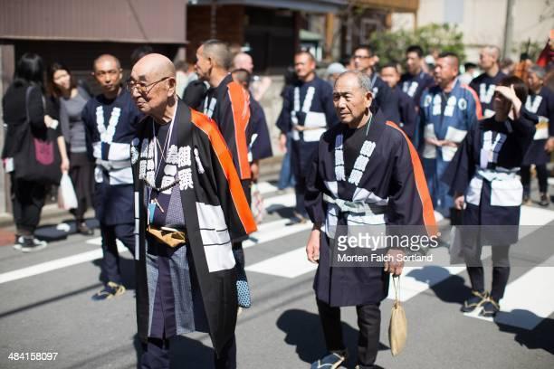 Elderly Japanese men walking in the streets at a sex festival in Tokyo Japan