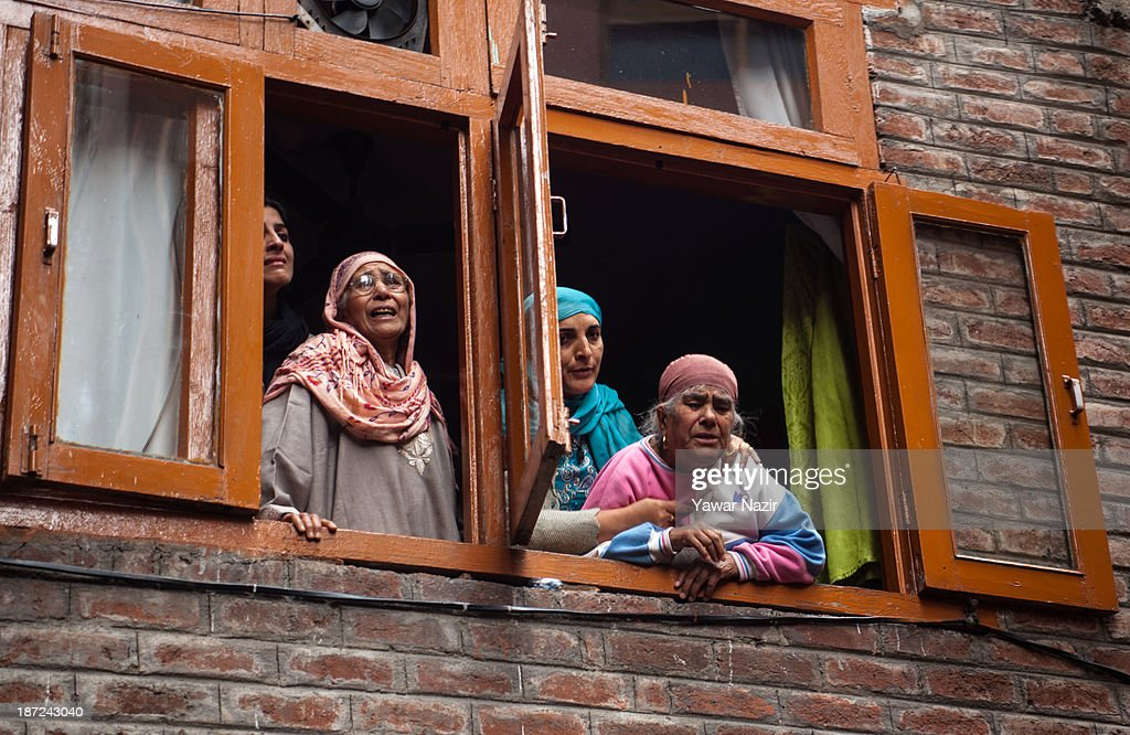 Elderly Kashmiri Muslim women cry after a fire that gutted residential houses on November 07, 2013, in Srinagar the summer capital of Indian administered Kashmir, India. Several families were left homeless in Maharaja Bazar locality in uptown Srinagar and no injuries were reported.