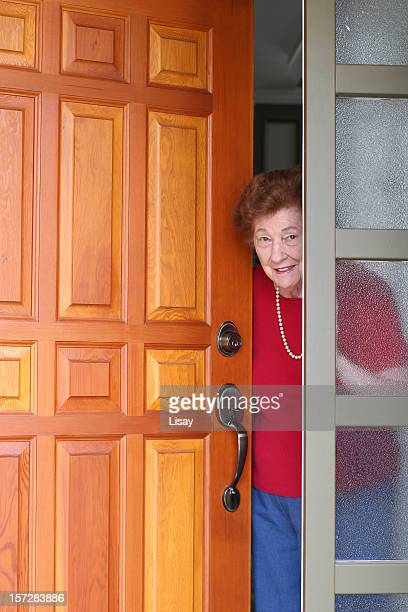 Elderly lady answering her front door