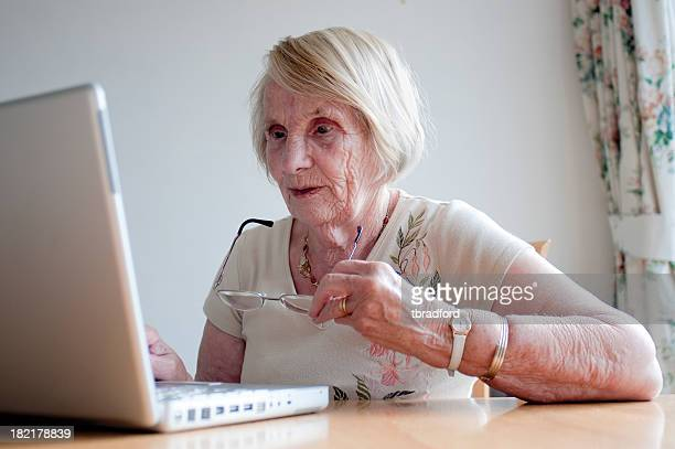 Elderly Lady Using A Laptop Computer