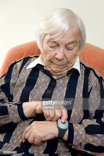 Elderly lady using emergency call system