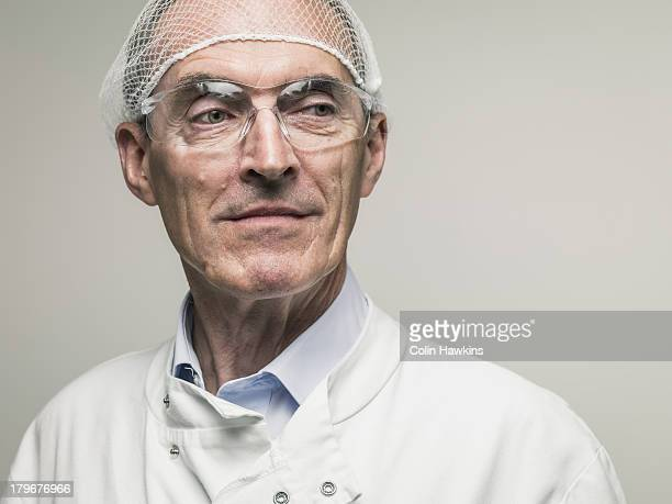 Elderly male in protective clothing