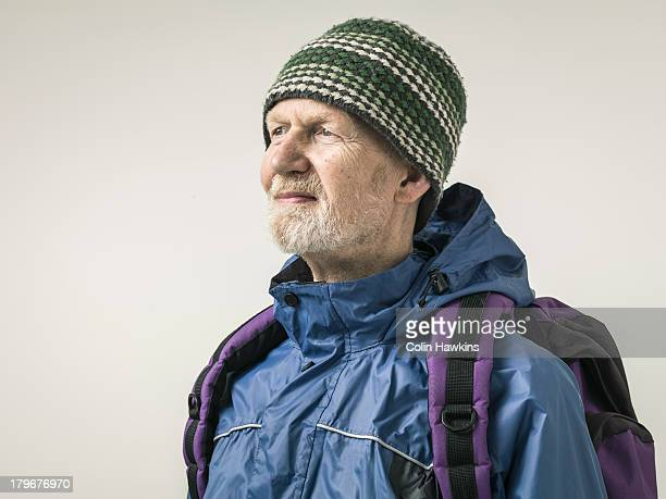 elderly male with backpack