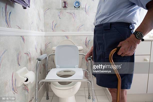elderly man and handicap toilet