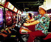Elderly man and woman on motorcycle arcade games