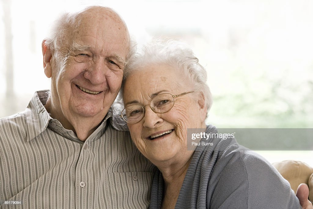 Elderly Man and Woman Sitting on Couch  : Stock Photo
