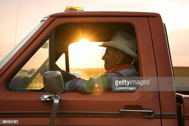 Elderly man driving truck