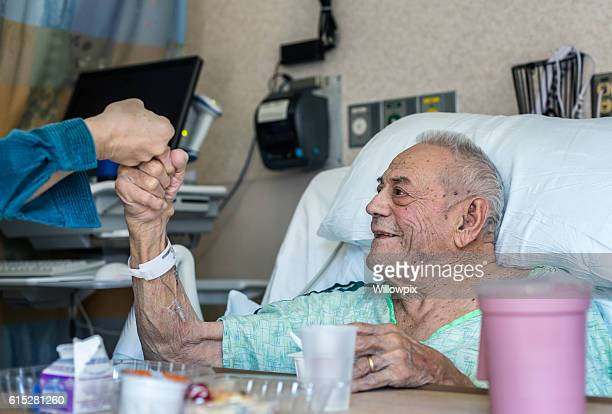 Elderly Man Hospital Patient Fist Bump Greeting Family Member