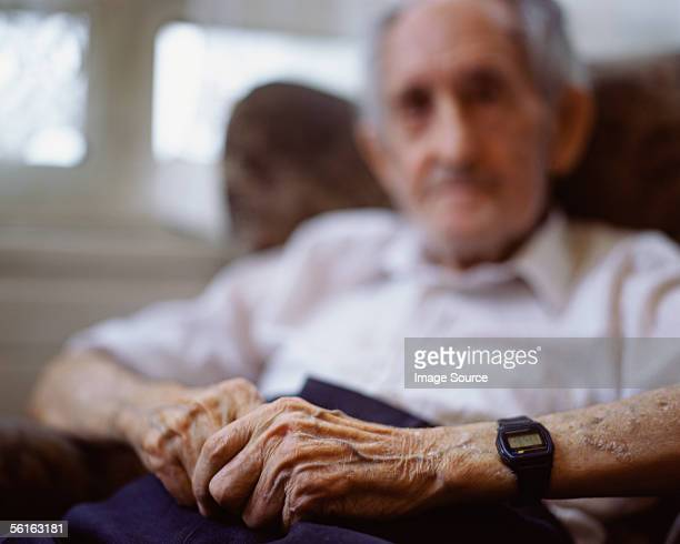 Elderly man in armchair