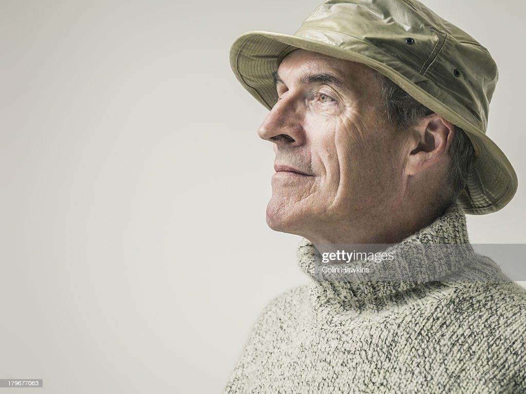 Elderly man in outdoor clothing