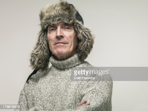 Elderly man in warm winter clothing
