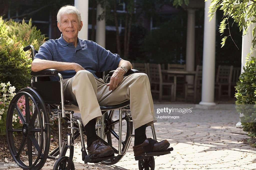 Elderly man in wheelchair outdoors stock photo getty images