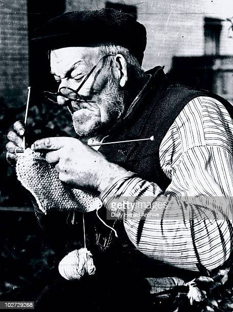 Elderly man knitting as part of the war effort during WWII 31 October 1939 'Everybody's knitting Mr Mark Whatmough of Harmondsworth in Middlesex who...