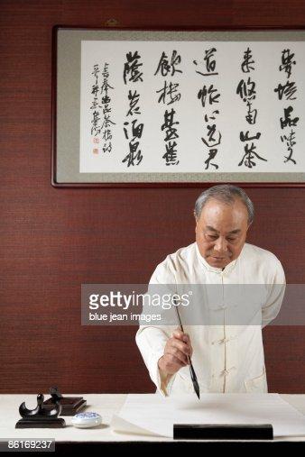 Elderly Man Practicing Calligraphy
