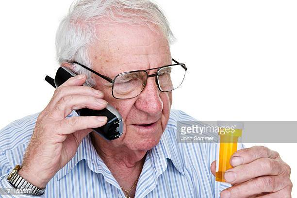 Elderly man refilling prescription