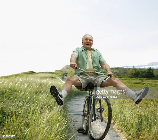 Elderly man riding bicycle