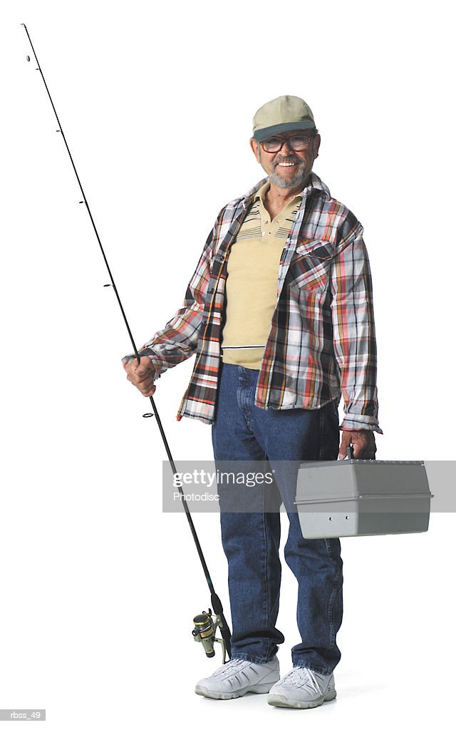 Elderly man smiles holding a fishing pole and a tackle box.