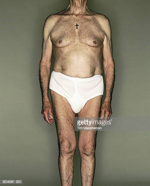 Elderly man wearing white Y-fronts, front view (cross-processed)