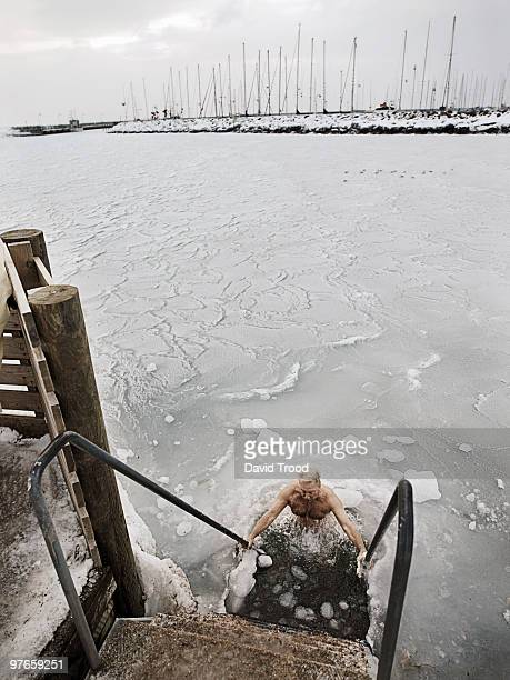Elderly man winter bathing