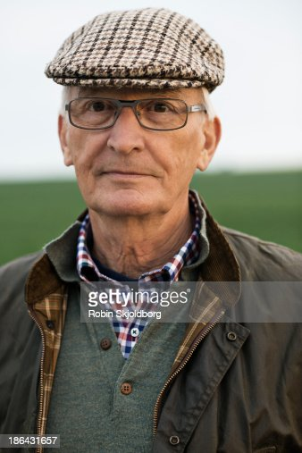 Elderly man with sixpence and glases
