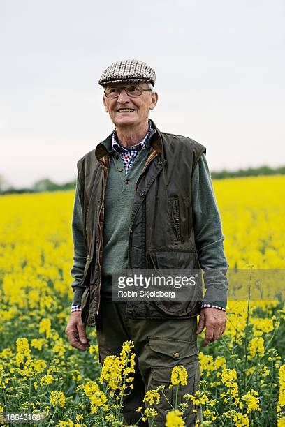 Elderly man with sixpence in yellow field