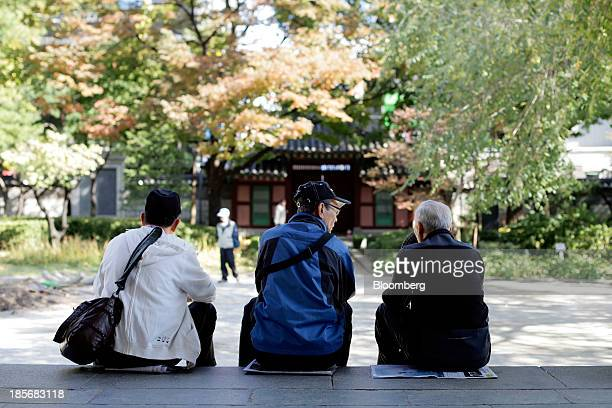 Elderly men chat as they sit on steps at Tapgol Park in the Jongrogu area of Seoul South Korea on Wednesday Oct 23 2013 President Park Geun Hye in...