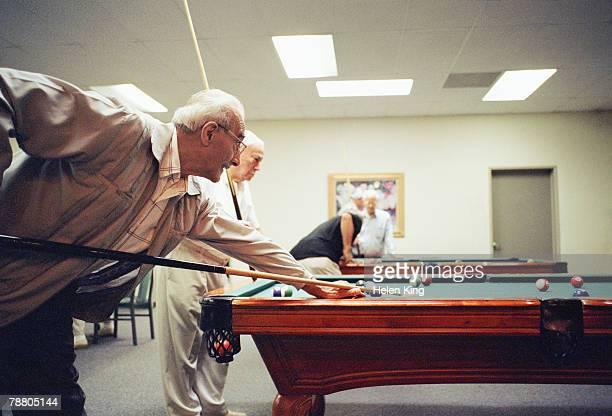 Elderly Men Playing Pool