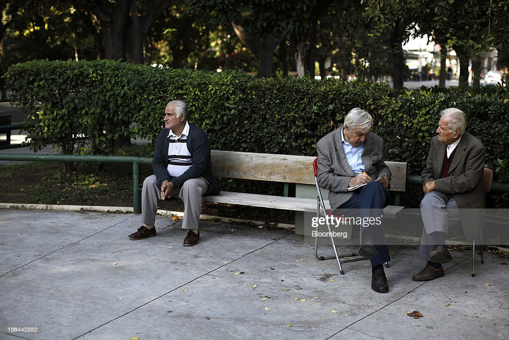 Elderly men sit and converse in a park area near Zappeion hall known as 'Little Parliament' in Athens, Greece, on Thursday, Nov. 15, 2012. Greece's Supreme Court of Audit ruled that Greek austerity measures including cuts to pensions and an increase in the retirement age may be unconstitutional, state-run Athens News Agency reports, without citing anyone. Photographer: Kostas Tsironis/Bloomberg via Getty Images