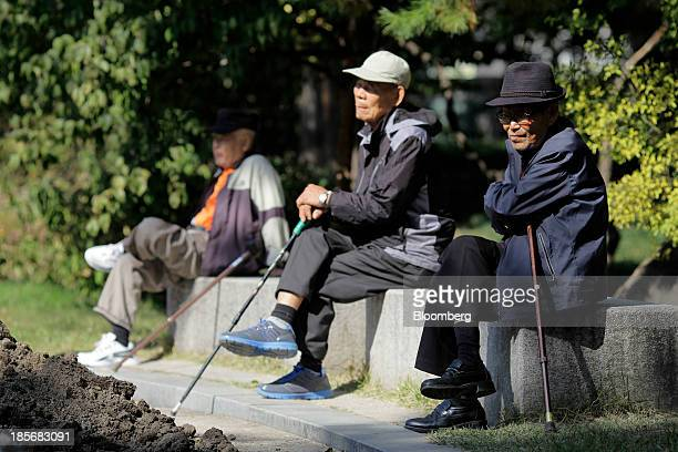 Elderly men sit on benches at Tapgol Park in the Jongrogu area of Seoul South Korea on Wednesday Oct 23 2013 President Park Geun Hye in her 2014...