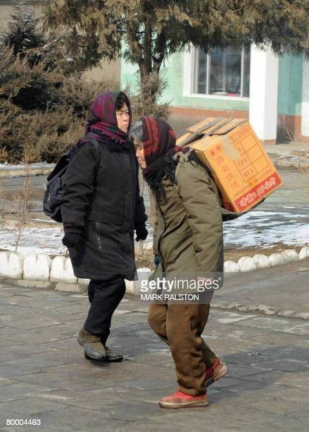 Elderly North Korean women walk on the streets of Pyongyang on February 26 2008 The isolated Stalinist state is due to host the New York Philharmonic...