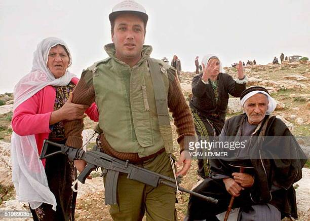 Elderly Palestinian Bedouins beg Israeli soldiers to stop Jewish settlers' activities south of Bethlehem on the West Bank 26 January 1995 Israelis in...
