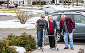 Elderly Parents and Daughter Returning Home From Hospital Emergency Room