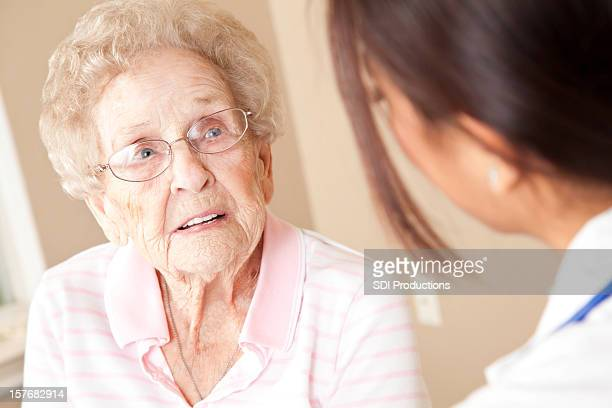 Elderly Patient Receiving Advice From Female Doctor