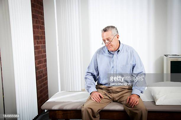 Elderly patient sitting at a doctor's office and waiting