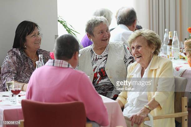 Elderly people chat over coffee during an afternoon gettogether in the community room of the Sewanstrasse senior care home in Lichtenberg district on...